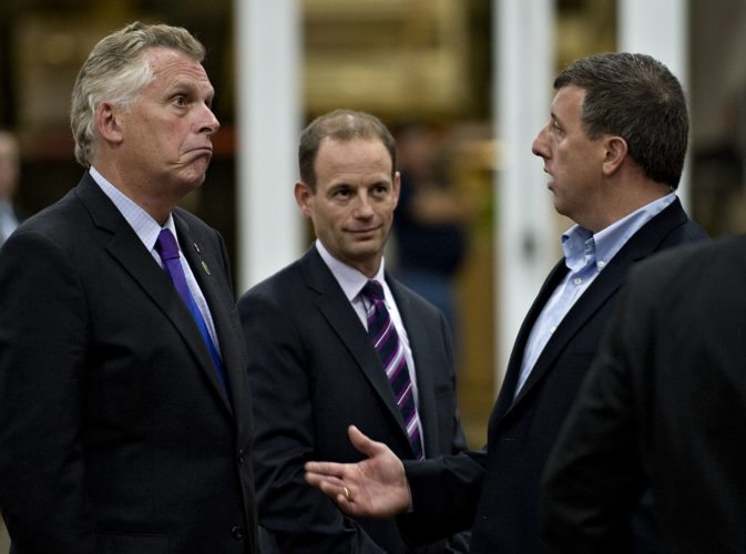 Virginia Gov. Terry McAuliffe, gets a tour inside the new manufacturing addition at Andros Foods in Mount Jackson by Jason Simpson, right, vice president of manufacturing,  and Thierry Jean, center, CEO at Andros.    Rich Cooley/Daily